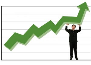 green stock chart guy holding up